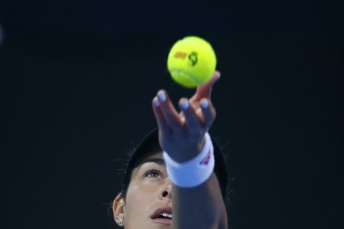 Ivanovic of Serbia serves to Sharapova of Russia during their women's singles semi-final match at the China Open tennis tournament in Beijing