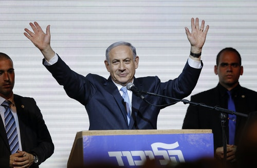 Israeli Prime Minister Benjamin Netanyahu waves to supporters at the party headquarters in Tel Aviv