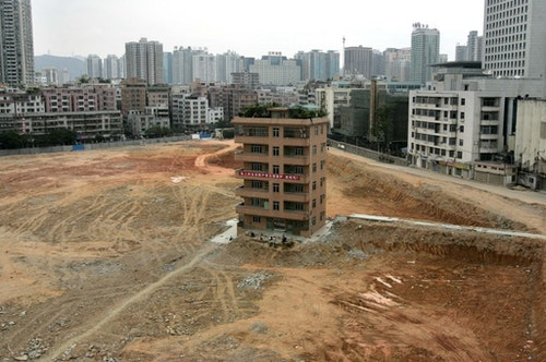 A six-floor villa is viewed on the construction site in the central business district of Shenzhen