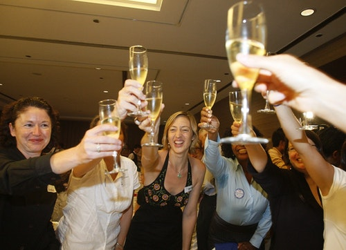 Democrats including Vanessa Batt (C) of New Jersey celebrate at the American Club in Singapore