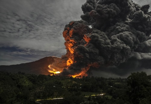 Mount Sinabung volcano erupts, as seen from Tiga Pancur village, Karo Regency in Indonesia's North Sumatra province
