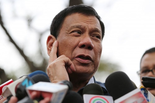 Philippine presidential candidate Rodrigo Duterte gestures as he answers questions from reporters at the University of the Philippines in suburban Quezon city, north of Manila, Philippines, Thursday, Feb. 18, 2016. Five candidates are running for President in the coming elections this May. (AP Photo/Aaron Favila)
