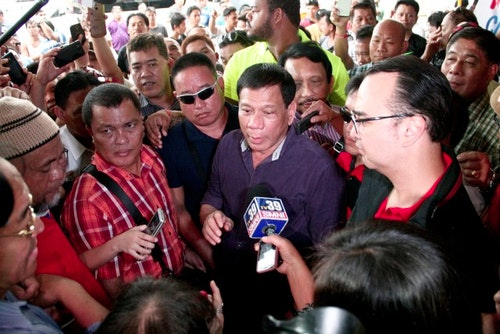 30 Nov 2015, Manila, Luzon Island, Philippines --- Nov. 30, 2015 - Philippines - Mayor Duterte answers ambush interviews as he makes his way in to the hotel's lobby. Davao Mayor Rodrigo Duterte formally made his proclamation to run for president in ..next year's national elections at the Century Park Sheraton Hotel in Malate, Manila. ..A staunch supporter of the death penalty, Mayor Duterte is also known, and have ..admitted in front of the media, to have personally killed known criminals in Davao ..City, has two wives and two girlfriends, and have recently cursed the Pope for ..causing him inconvenience while stuck on a traffic jam during Pope Francis' visit ..last January in Manila. (Credit Image: © J Gerard Seguia via ZUMA Wire) --- Image by © J Gerard Seguia/ZUMA Press/Corbis
