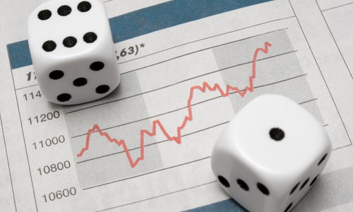 Pair of dice on stock chart.