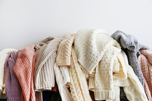 bunch-of-sweaters-of-different-material-